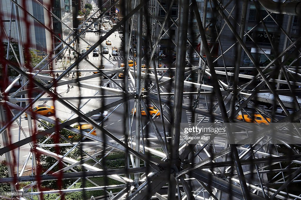 Columbus Circle is viewed through the scaffolding of the 810-square-foot 'living room' art installation by Japanese artist Tatzu Nishi which features the iconic 13-foot statue of Christopher Columbus on September 19, 2012 in New York City. Viewed as a piece of conceptual art, 'Living Room', which sits 70-feet above ground level and is only accessible via a scaffold-encased staircase, has been temporarily built around the Columbus Monument in Columbus Circle. Beginning Thursday, up to 25 people at a time can enter the living room to view up close the 1892 marble figure of the Italian explorer.