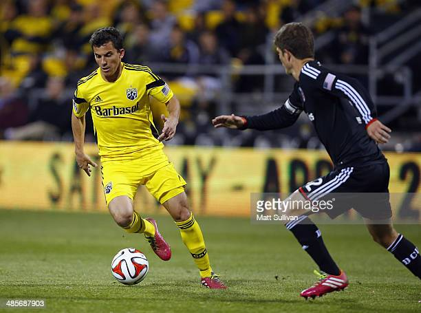 Columbus Crew midfielder Bernardo Anor dribbles around DC United defender Bobby Boswell during the second half of their game at Columbus Crew Stadium...