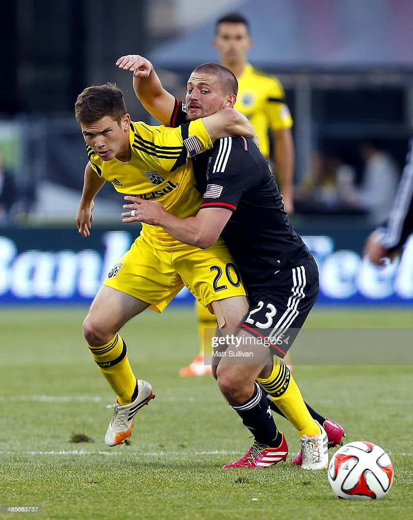 Columbus Crew midfielder Wil Trapp (20) fights for the ball with D.C. United midfielder Perry Kitchen (23) during the first half of their game at Columbus Crew Stadium on April 19, 2014 in Columbus, Ohio.