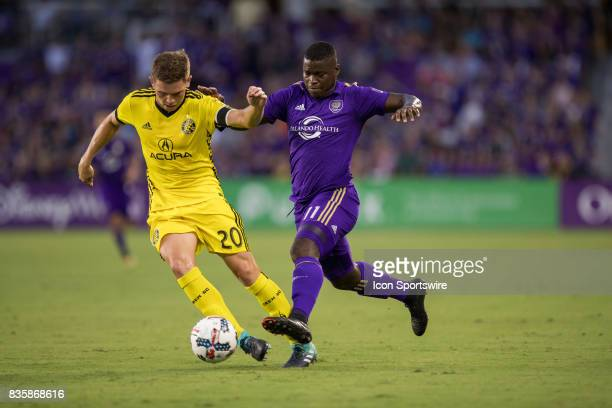 Columbus Crew midfielder Will Trapp and Orlando City SC forward Carlos Rivas go for the ball during the MLS soccer match between Orlando City SC and...