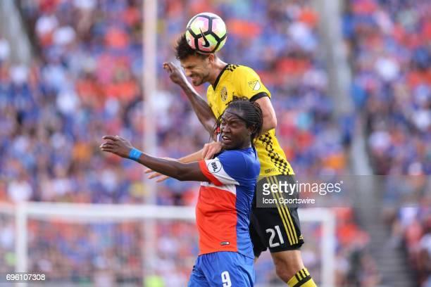 Columbus Crew SC defender Alex Crognale headers a ball with FC Cincinnati forward Djiby Fall defending during the match between the Columbus Crew SC...