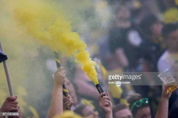 Columbus Crew SC fan celebrates a goal while releasing a yellow smoke bomb during the game between the Philadelphia Union at Columbus Crew SC held at...