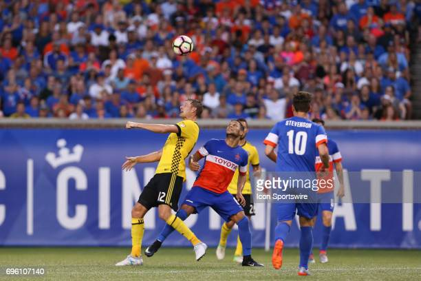 Columbus Crew SC forward Adam Jahn headers a ball during the match between the Columbus Crew SC and FC Cincinnati on June 14 2017 at Nippert Stadium...