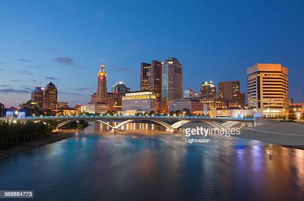 Columbus, Ohio skyline and Scioto River at night.