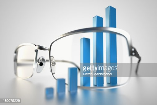 Column bar chart around spectacles glasses : Stock Photo