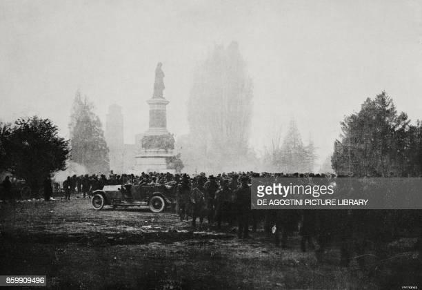 A column of Austrian prisoners passing in front of the monument to Dante Alighieri Trento Italy World War I from l'Illustrazione Italiana Year XLV No...