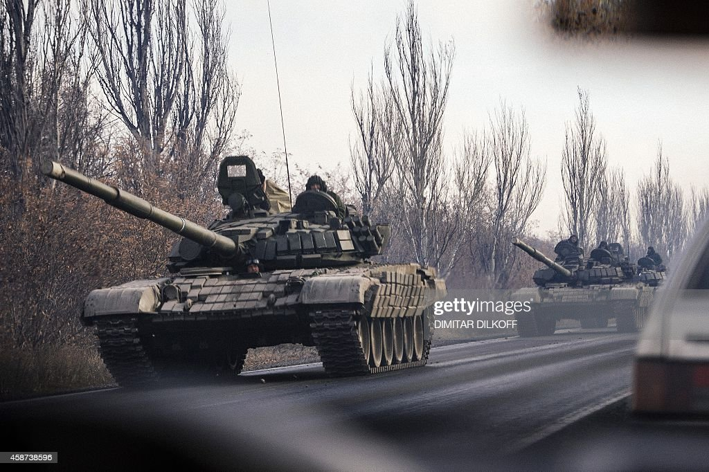 A column of tanks drive from a rebelterritory to Donetsk near the town of Shakhtarsk eastern Ukraine on November 10 2014 New unidentified armoured...