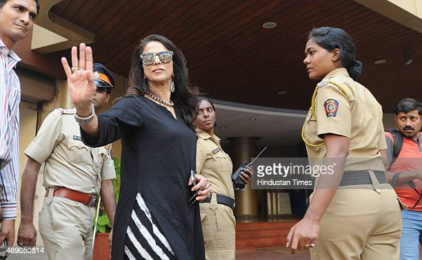 Columnist and novelist Shobha de interacts with the media during protest by Shiv Sena and RPI party workers outside her house by presenting Vada Pav...