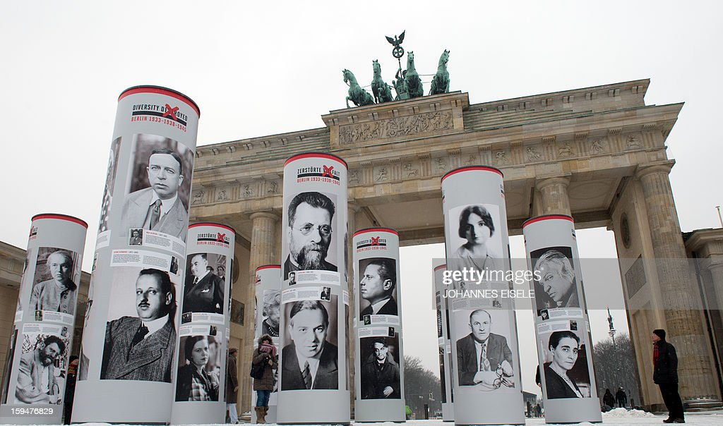 Columns with photographs of nazi victims, who used to live in Berlin and to form the urban life in the German capital before the takeover of the Nazis, stand in front of the Brandenburg Gate in Berlin on January 14, 2013, as part of a portrait exhibition. The German capital started in a theme year titled 'Diversity Destroyed - Berlin 1933 - 1938 - 1945', that, according to organisers, aims to highlight the social and cultural diversity that was destroyed in Berlin under the National Socialist regime in the years following 1933. The eightieth anniversary of the Nazis' accession to power on January 30, 1933 and the seventy-fifth anniversary of the November Pogroms, symbolized by the terror of November 9 1938, are cornerstones in a year of commemoration, remembrance and engagement with the past.