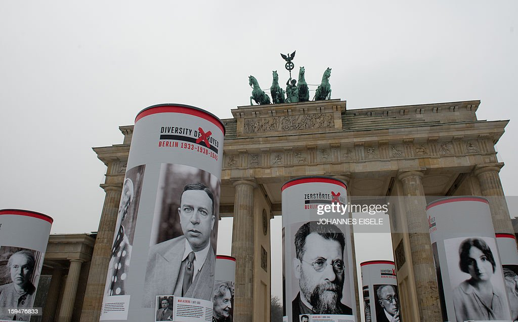 Columns with photographs of nazi victims, who used to live in Berlin and to form the urban life in the German capital before the takeover of the Nazis, stand in front of the Brandenburg Gate in Berlin on January 14, 2013, as part of a portrait exhibition. The German capital started in a theme year titled 'Diversity Destroyed - Berlin 1933 - 1938 - 1945', that, according to organisers, aims to highlight the social and cultural diversity that was destroyed in Berlin under the National Socialist regime in the years following 1933. The eightieth anniversary of the Nazis' accession to power on January 30, 1933 and the seventy-fifth anniversary of the November Pogroms, symbolized by the terror of November 9 1938, are cornerstones in a year of commemoration, remembrance and engagement with the past. AFP PHOTO / JOHANNES EISELE
