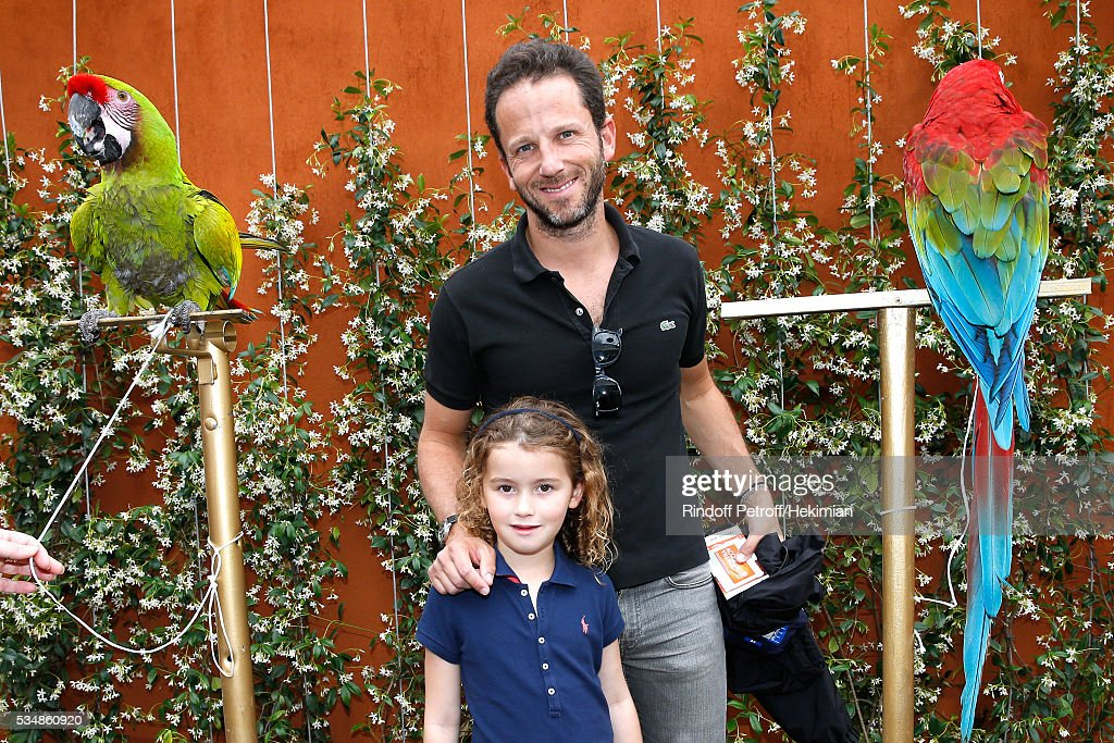 Co-Manager of Etam, Laurent Milchior and his daughter attend Day Seven of the 2016 French Tennis Open at Roland Garros on May 28, 2016 in Paris, France.