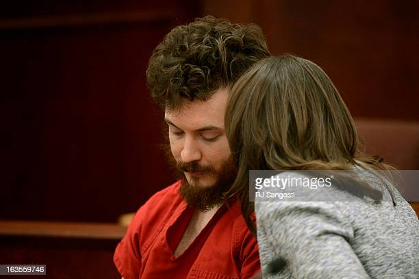 Aurora theater shooting suspect James Holmes confers with Defense attorney Tamara Brady in the courtroom during his arraignment Tuesday March 12 2013...