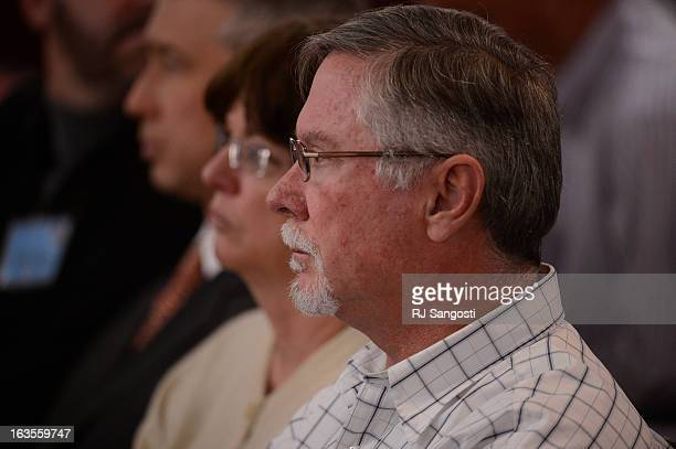 Aurora theater shooting suspect James Holmes' parents Arlene and Robert Holmes watch the proceedings for their son during his arraignment Tuesday...