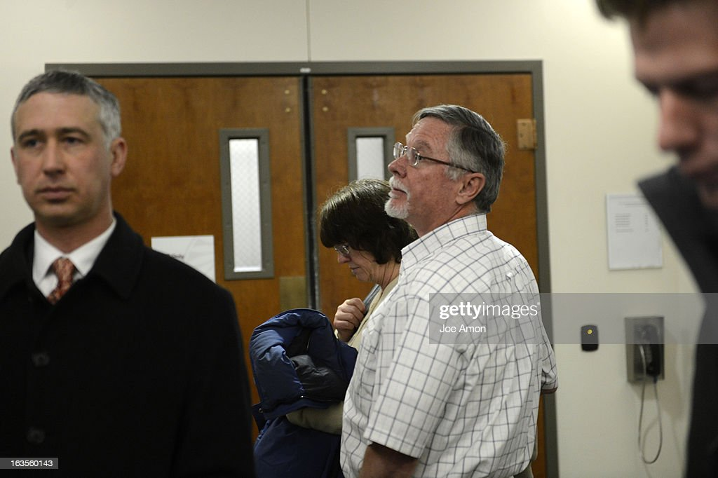 Aurora theater shooting suspect James Holmes' parents Arlene and Robert Holmes leave the courtroom after the proceedings for their son during his arraignment Tuesday March 12, 2013. District Court Judge William Sylvester entered a Not Guilty plea on behalf of Holmes. The trial begins August 5, 2013. The arraignment for Aurora theater shooting suspect James Holmes for the July 20, 2012 shooting at the Century 16 theater in Aurora, CO that killed 12 people and injured 70 others.