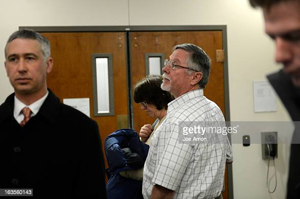 Aurora theater shooting suspect James Holmes' parents Arlene and Robert Holmes leave the courtroom after the proceedings for their son during his...