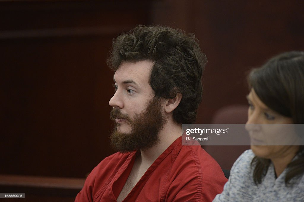 Aurora theater shooting suspect James Holmes with Defense attorney Tamara Brady in the courtroom during his arraignment Tuesday March 12, 2013. District Court Judge William Sylvester entered a Not Guilty plea on behalf of Holmes. The trial begins August 5, 2013. The arraignment for Aurora theater shooting suspect James Holmes for the July 20, 2012 shooting at the Century 16 theater in Aurora, CO that killed 12 people and injured 70 others.