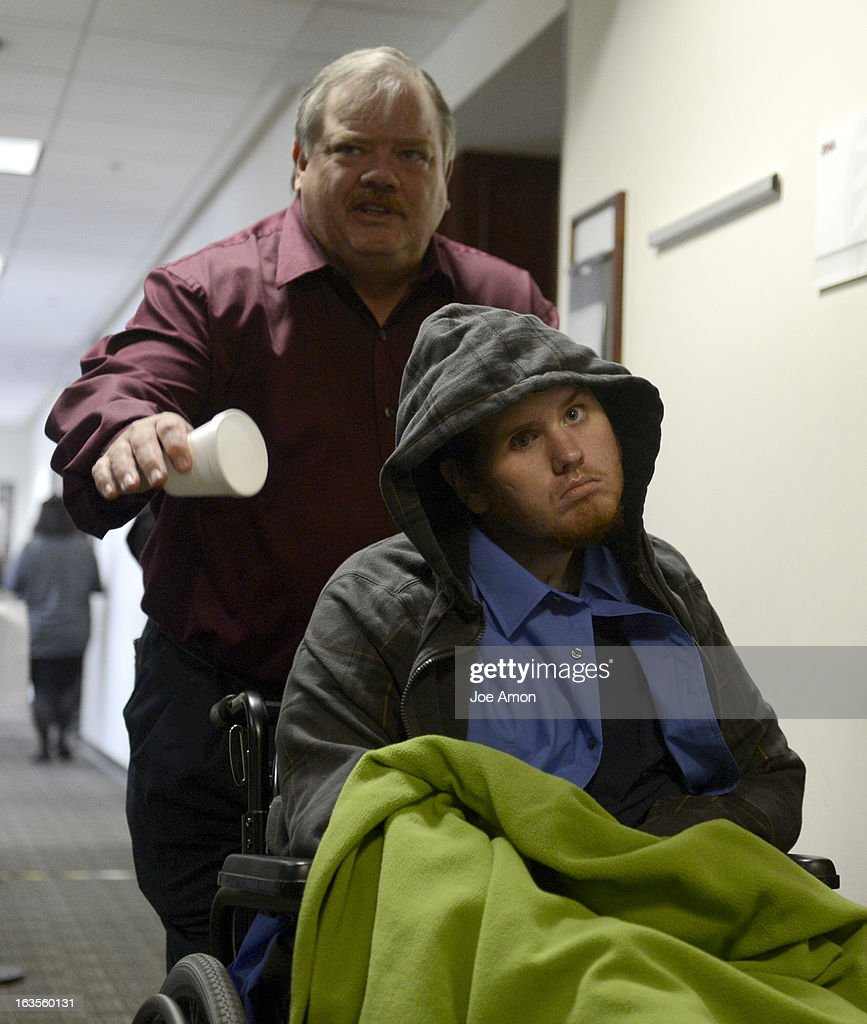 Aurora theater shooting victim Caleb Medley and his father Otis Medley leave the second floor of the Arapahoe County Courthouse, Tuesday March 12, 2013 after the proceedings. District Court Judge William Sylvester entered a Not Guilty plea on behalf of Holmes. The trial begins August 5, 2013. The arraignment for Aurora theater shooting suspect James Holmes for the July 20, 2012 shooting at the Century 16 theater in Aurora, CO that killed 12 people and injured 70 others.