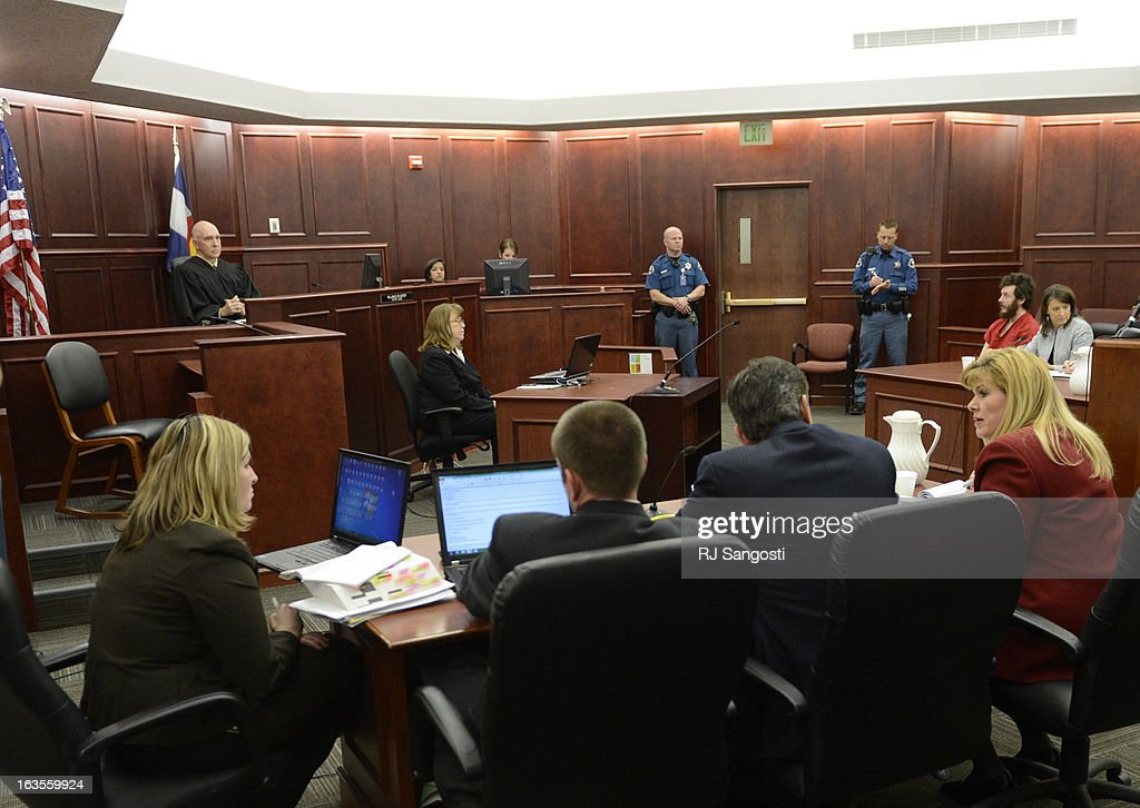 Prosecutor Karen Pearson, dressed in red suit, and the prosecution team at their table during the proceedings where District Court Judge William Sylvester entered a Not Guilty plea on behalf of Holmes. The trial is set to begin August 5, 2013. The arraignment for Aurora theater shooting suspect James Holmes for the July 20, 2012 shooting at the Century 16 theater in Aurora, CO that killed 12 people and injured 70 others.