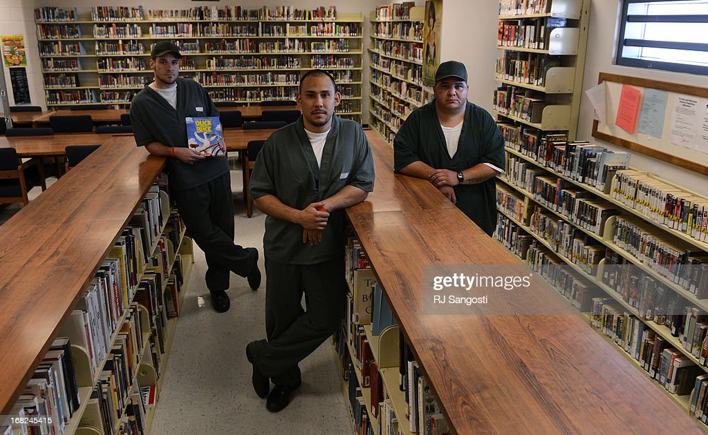 Inmates Erik Miller, left, Ricardo Garcia, center, and Steven Romero took part in a prison program where they got to recorded themselfs reading a children's book at Sterling Correctional Facility, May 07, 2013. The program will send a DVD copy of him reading the book to children important to the men on the outside.