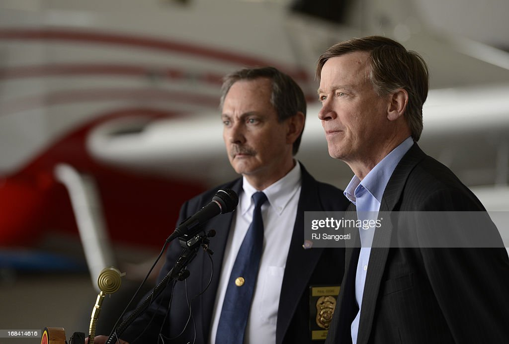 Inside a hanger at Centennial Airport Director at Colorado Division of Fire Prevention and Control Paul Cooke, left, and Colorado Governor John Hickenlooper give the annual Colorado wildfire briefing, May 09, 2013. Both hope this years fire season in Colorado will be much better then last years.