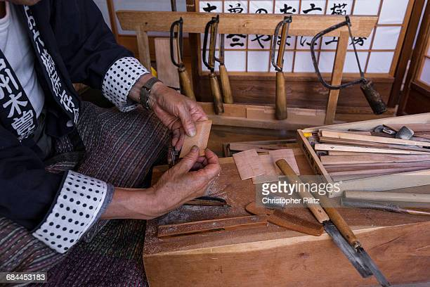 Comb making craftsman at work in small studio