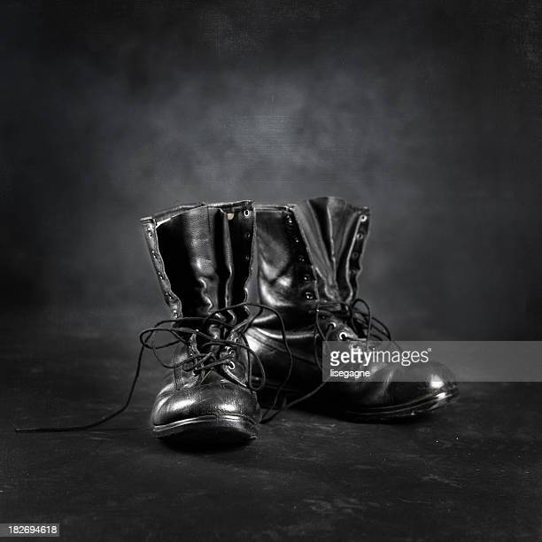 Combat black leather boots, untied