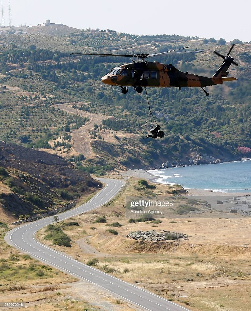 A combat helicopter is in action during the Efes-2016 Combined Joint Live Fire Exercise at Seferihisar district of Izmir, Turkey on May 31, 2016. The Turkish-led multinational military exercises, Efes-2016 which started at 04 May and will be finished at 04 June 2016, aims to train participating units and staff in planning and conducting combined and joint operations, including logistics and command-control as well as to improve the level of interoperability among headquarters and forces.