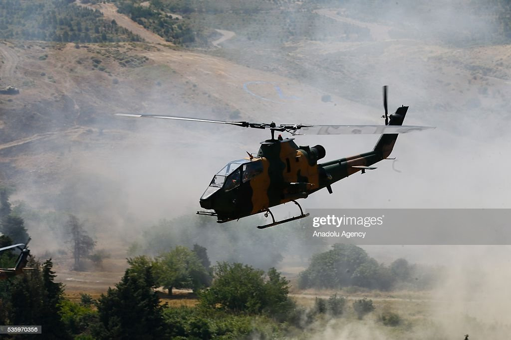 Combat helicopter is in action during the Efes-2016 Combined Joint Live Fire Exercise at Seferihisar district of Izmir, Turkey on May 31, 2016. The Turkish-led multinational military exercises, Efes-2016 which started at 04 May and will be finished at 04 June 2016, aims to train participating units and staff in planning and conducting combined and joint operations, including logistics and command-control as well as to improve the level of interoperability among headquarters and forces.