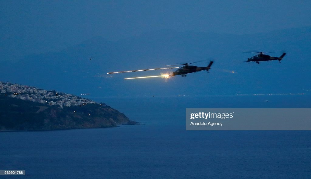Combat helicopters are in action during the Efes-2016 Combined Joint Live Fire Exercise at Seferihisar district of Izmir, Turkey on May 30, 2016. The Turkish-led multinational military exercises, Efes-2016 which started at 04 May and will be finished at 04 June 2016, aims to train participating units and staff in planning and conducting combined and joint operations, including logistics and command-control as well as to improve the level of interoperability among headquarters and forces.