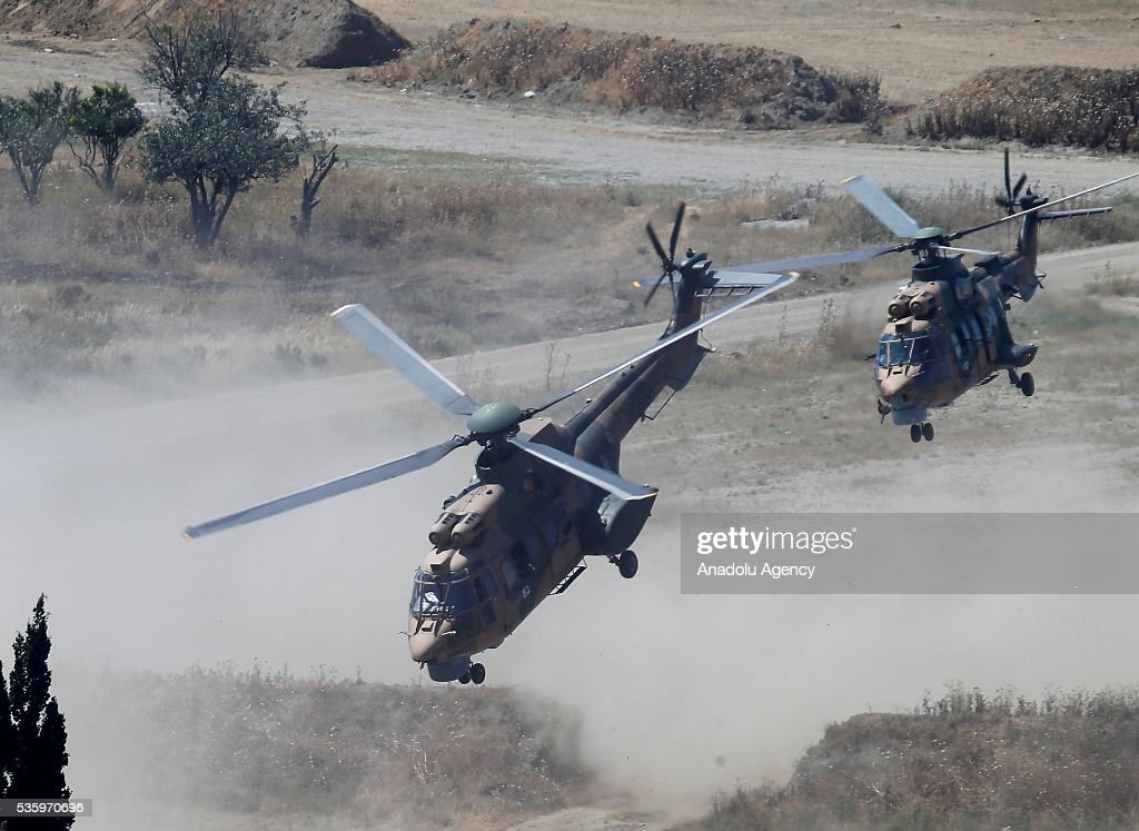 Combat helicopters are in action during the Efes-2016 Combined Joint Live Fire Exercise at Seferihisar district of Izmir, Turkey on May 31, 2016. The Turkish-led multinational military exercises, Efes-2016 which started at 04 May and will be finished at 04 June 2016, aims to train participating units and staff in planning and conducting combined and joint operations, including logistics and command-control as well as to improve the level of interoperability among headquarters and forces.