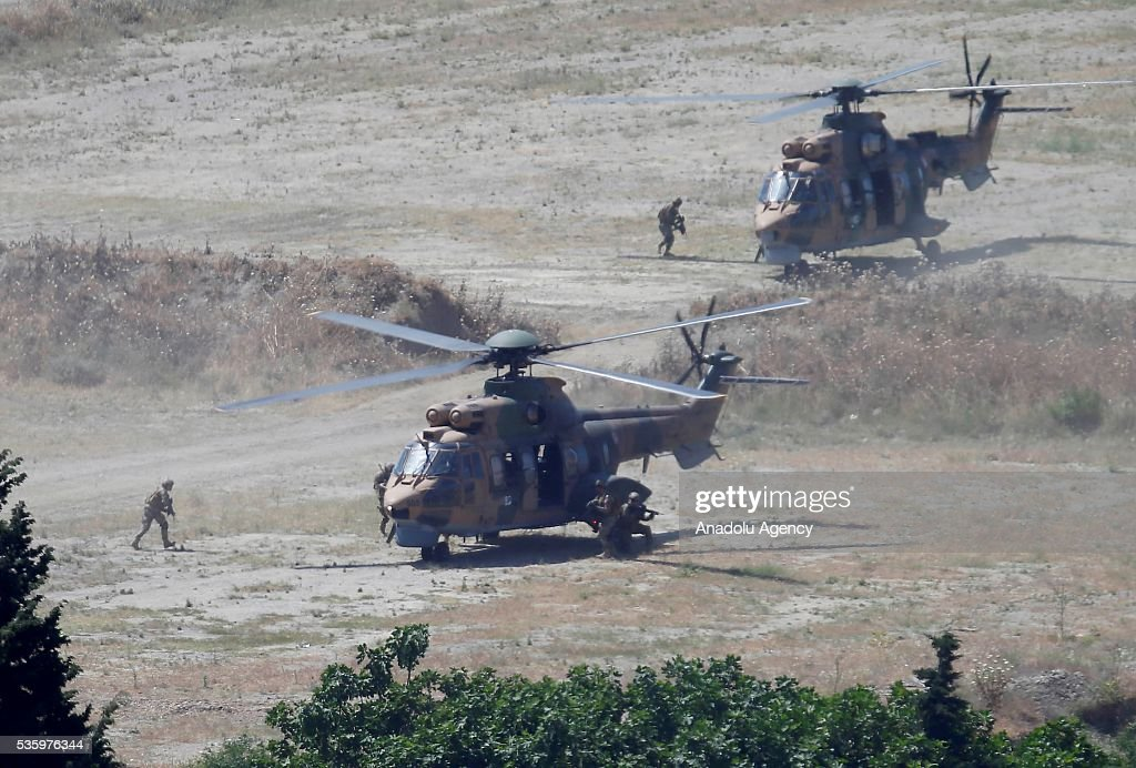 Combat helicopters are seen during the Efes-2016 Combined Joint Live Fire Exercise at Seferihisar district of Izmir, Turkey on May 31, 2016. The Turkish-led multinational military exercises, Efes-2016 which started at 04 May and will be finished at 04 June 2016, aims to train participating units and staff in planning and conducting combined and joint operations, including logistics and command-control as well as to improve the level of interoperability among headquarters and forces.