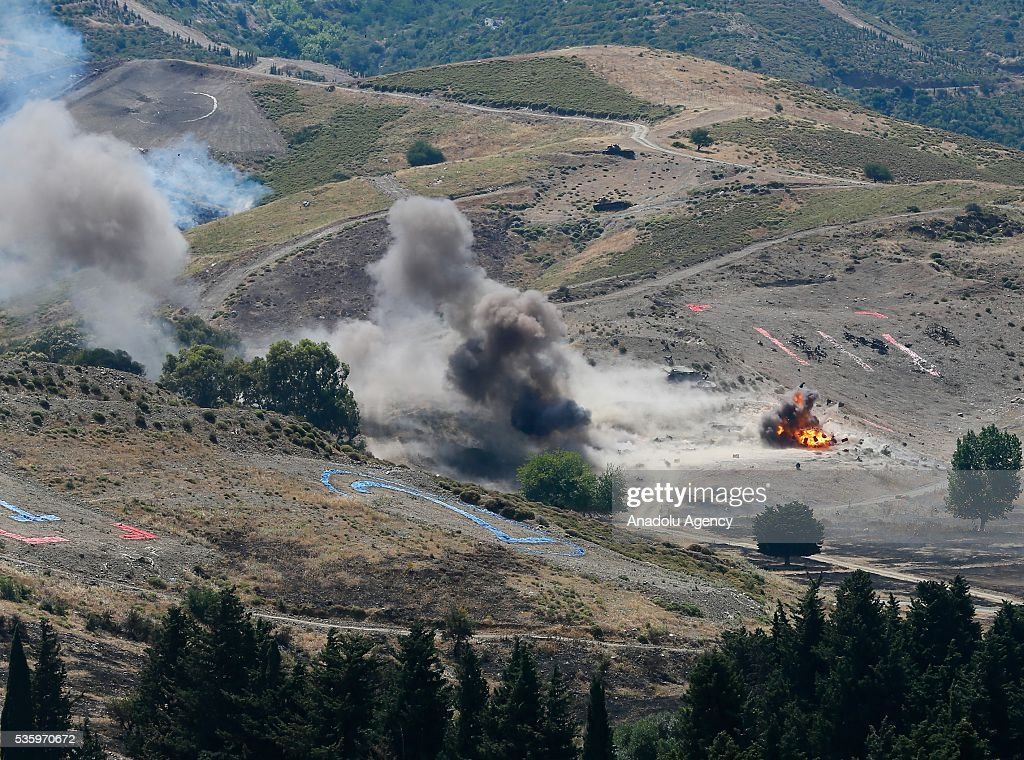 Combat helicopters hit their targets during the Efes-2016 Combined Joint Live Fire Exercise at Seferihisar district of Izmir, Turkey on May 31, 2016. The Turkish-led multinational military exercises, Efes-2016 which started at 04 May and will be finished at 04 June 2016, aims to train participating units and staff in planning and conducting combined and joint operations, including logistics and command-control as well as to improve the level of interoperability among headquarters and forces.