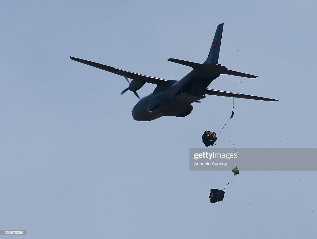 Combat plane drops ammunition during the Efes-2016 Combined Joint Live Fire Exercise at Seferihisar district of Izmir, Turkey on May 31, 2016. The Turkish-led multinational military exercises, Efes-2016 which started at 04 May and will be finished at 04 June 2016, aims to train participating units and staff in planning and conducting combined and joint operations, including logistics and command-control as well as to improve the level of interoperability among headquarters and forces.