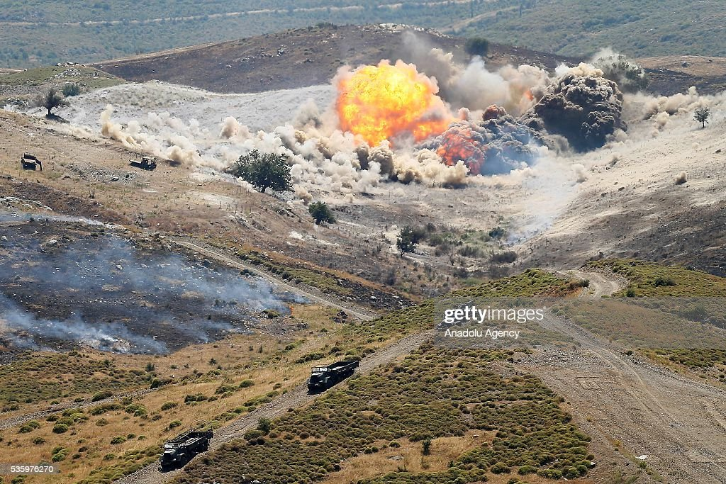 Combat planes hit their targets during the Efes-2016 Combined Joint Live Fire Exercise at Seferihisar district of Izmir, Turkey on May 31, 2016. The Turkish-led multinational military exercises, Efes-2016 which started at 04 May and will be finished at 04 June 2016, aims to train participating units and staff in planning and conducting combined and joint operations, including logistics and command-control as well as to improve the level of interoperability among headquarters and forces.