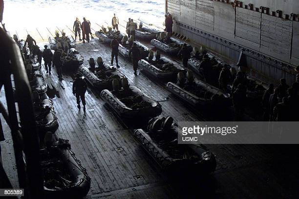 Combat Rubber Reconnaissance Crafts from Battalion Landing Team 2/2's Golf Company sit in the well deck of USS Austin September 26 2000 prior to an...