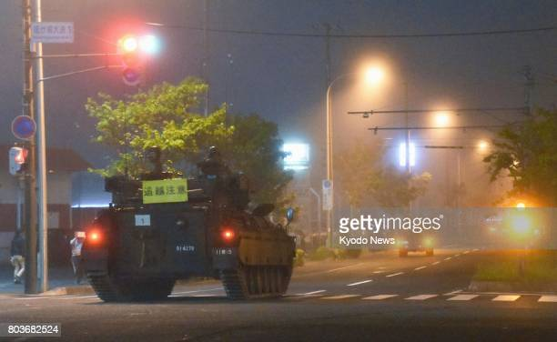 A combat vehicle of the Ground SelfDefense Force travels on a public road in the northern Japan city of Kushiro on June 29 2017 The vehicle together...