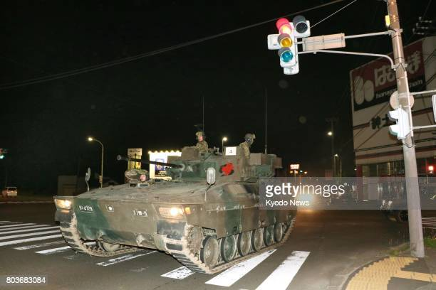 A combat vehicle of the Ground SelfDefense Force travels on a public road in the northern Japan city of Chitose on June 28 2017 The vehicle together...