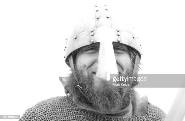 A combatant poses as he prepares to fight in the Viking Battle reenactment as part of the St Ives Medieval Faire on September 24 2017 in Sydney...