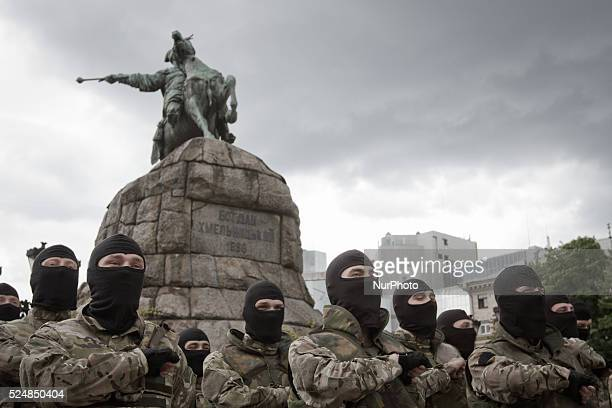 Combatants of Ukrainian Azov battalion pray near Bohdan Khmelnytsky monument before they were sent on a theater of ATO