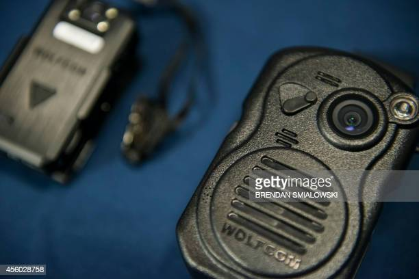 A combination body camera radio microphone from Wolfcam is seen during a press conference at City Hall September 24 2014 in Washington DC The...