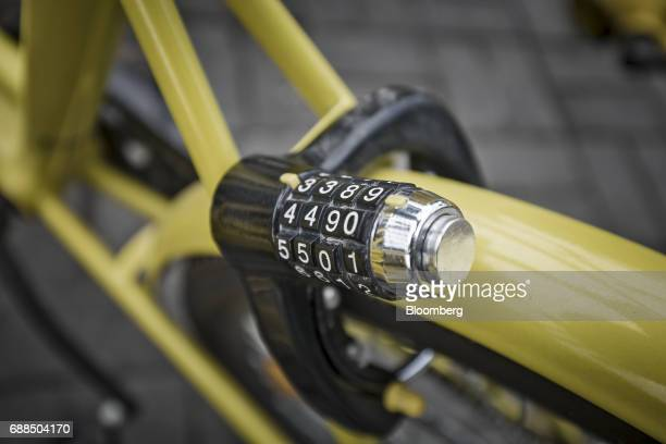 A combination lock is seen on an Ofo Inc bicycle parked on a sidewalk in Shanghai China on Thursday May 25 2017 In China a bicyclesharing phenomenon...