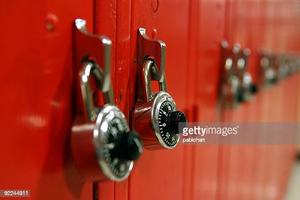 Combination locks on a row of red high school lockers