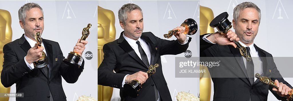 Combination of 3 pictures shows Director Alfonso Cuarón , winner of Best Achievement in Directing for 'Gravity', pose in the press room during the 86th Academy Awards on March 2, 2014 in Hollywood, California. AFP PHOTO / Joe KLAMAR