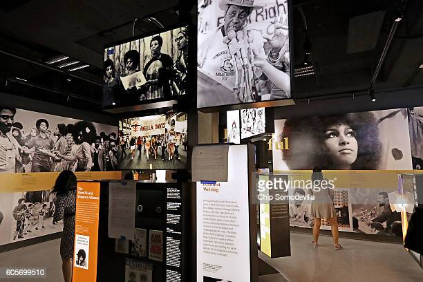 A combination of video screens printed information photographs posters and other artifacts fill the '1968 and Beyond' History Galleries at the...