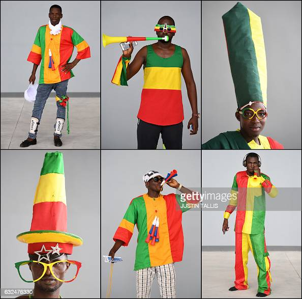 TOPSHOT Combination photo made on 23 January 2017 shows Mali supporter posing ahead of the 2017 Africa Cup of Nations group D football match between...