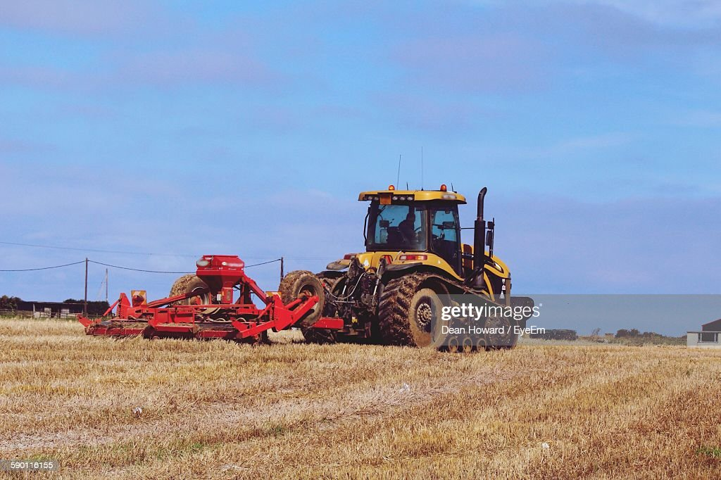 Combine Harvester Tractor On Field Against Sky