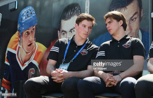 Combine Top Prospects Nolan Patrick and Nico Hischier chat beside a photo of Wayne Gretzky during festivities at the NHL Centennial Fan Arena at...