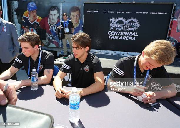 Combine Top Prospects Nolan Patrick Nico Hischier and Casey Mittelstadt sign autographs at the NHL Centennial Fan Arena at KeyBank Center on June 2...
