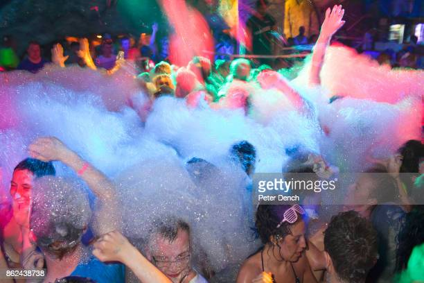A combined British tour operator crowd including Escapades and Club 1830 on the dance floor during a foam party at the Club Ice Ayia Napa Cyprus