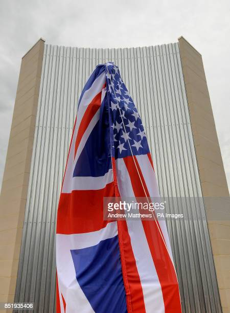 A combined United States and Union flag drape covers the Samuel Cody statue where it is being unveiled at the Farnborough Air Sciences Trust to mark...